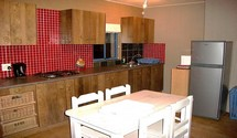 tuscan sun apartment struisbaai kitchen and dining area for guests